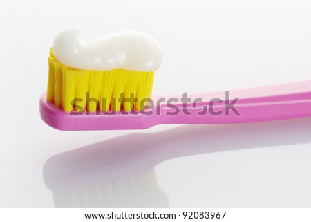 Pink Toothbrush with Toothpaste Isolated on White Background