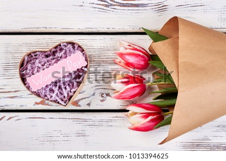 Pink tulips and gift box with message mockup. Elegant mono bouquet with craft paper wrapping. Simple and heart-touching present. #1013394625
