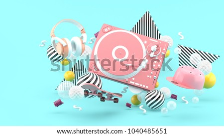 Pink turntable , cap ,skateboard and pink headphones are among colorful balls on a blue background.-3d render