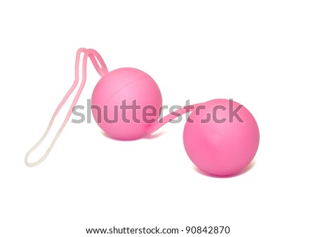 Pink vaginal balls it is isolated on a white background.