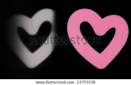Pink valentine heart with black and white reflection - stock photo