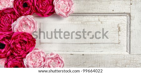Pink vintage flowers on aged cracked door panel #99664022