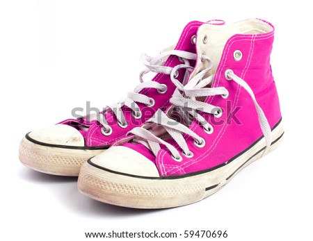pink vintage sneakers on white background.