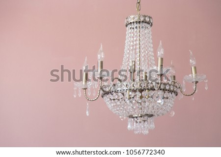Pink wall and chandelier