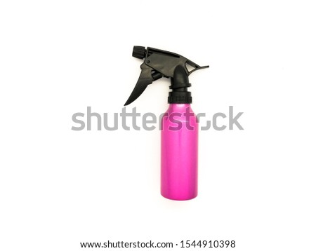 Pink water spray isolated on a white background. Hairdressing professional sprayer. Barber bottle for haircuts