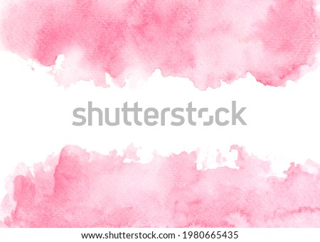 pink watercolor paint on paper background