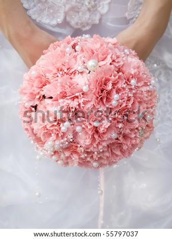 stock photo pink wedding bouquet at bride 39s hands
