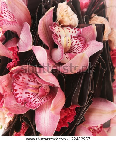 pink wedding bouquet of orchids as a background