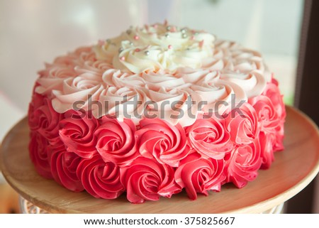 Pink  wedding cake decorated with cream roses close up