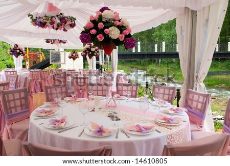 stock photo Pink wedding tables in outdoor restaurant