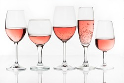 Pink wine on glass and white background