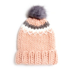 Pink Wool Cable Knit Ski Hat with Faux Fur Pompom Isolated on White. Bobble Hat Topped with Pom Pom or Loose Tassels. Knit Cap Folded Brim. Knitted Warm Hat. Tuque or Toque Outdoors Headgear