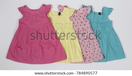 Pink, yellow, blue group of dresses, dress for girl, flat style kids dress, isolated