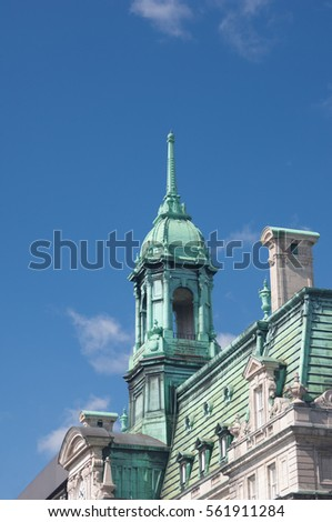 Shutterstock Pinnacle, cupula and mansard roof of the New French Imperialist-style architecture of City Hall in Old Montreal, Montreal, Quebec, Canada.