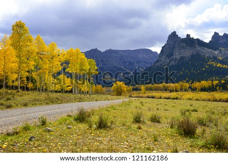 Pinnacle Ridge on Owl Creek Pass with golden and green aspen during fall in Colorado - stock photo