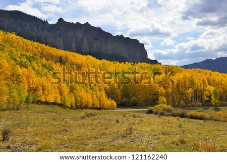 Pinnacle Ridge on Owl Creek Pass with golden and green aspen during fall in Colorado