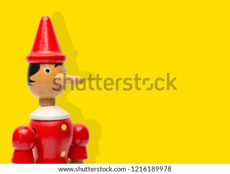 Pinocchio Toy Statue on a Colored Background