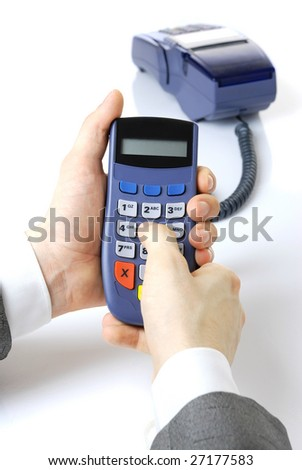 Pinpad and terminal with a card. Pinpad in hands at the businessman.