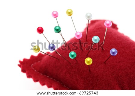 Pins and pincushion - stock photo