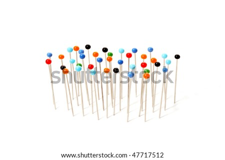 pins with colored heads isolated on white background