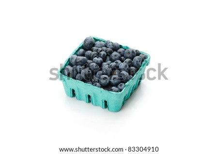Pint container of freshly picked blueberries on white - stock photo