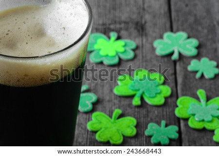 Pint of Stout Beer with Green Shamrock Stock photo ©