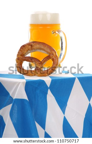 pint with pretzel and Bavarian flag / munich beer festival - stock photo