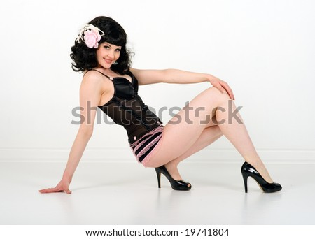 Pinup model in pink and black lingerie smiles