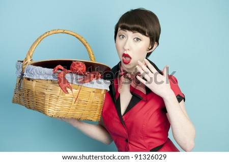 Pinup model with red lobster with surprised expression