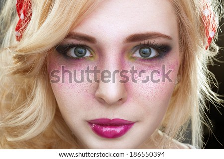 Pinup retro vintage Bright colorful creative make-up on woman face with powder on skin in studio
