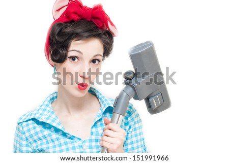 Pinup woman and vacuum cleaner