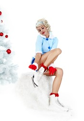 Pinup woman in winter style with skates. Isolated on white background