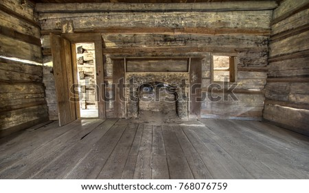 Pioneer Log Cabin Interior. Wooden interior of historic pioneer cabin living room. This is a historical structure in the Great Smoky Mountains National Park and not a privately owned residence.