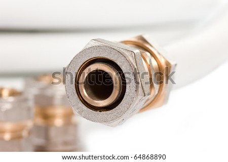 Pipe and adjustable spanner on a white background close up