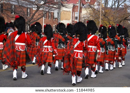Pipe and drum band performing during annual Scottish Christmas Walk parade in City of Alexandria Old Town Washington DC area
