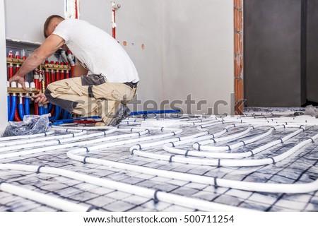 Pipe fitter mounted underfloor heating. Heating system and underfloor heating. #500711254