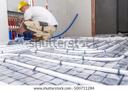 Shutterstock Pipe fitter mounted underfloor heating. Heating system and underfloor heating.