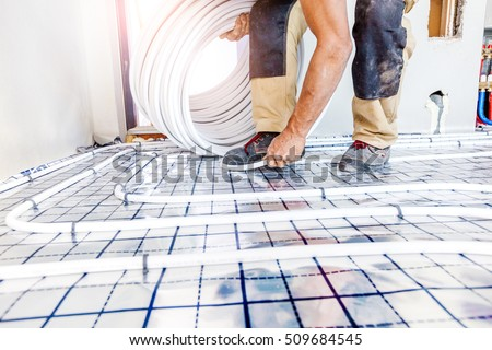 Shutterstock Pipe fitter mounted underfloor heating. Heating system and underfloor heating.