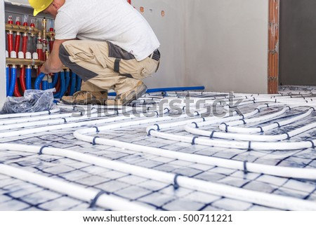 Pipe fitter mounted underfloor heating. Heating system and underfloor heating. Central heating #500711221