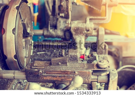 Pipe making by the threading machine. The lathe machine or turning machine cutting the thread at the end of metal pipe or tube. Classic manufacturing process.