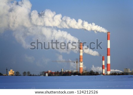 Pipe with smoke, urban landscape in winter, the environment, global warming, greenhouse effect