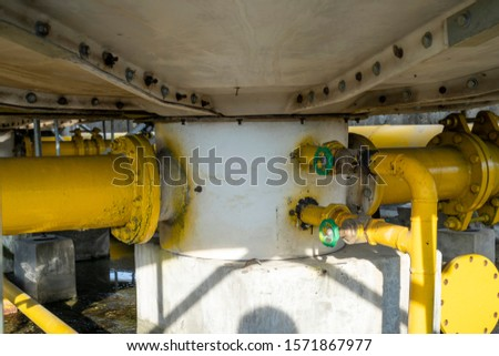 Pipelines and valves of water-cooled air conditioning system under cooling tower.