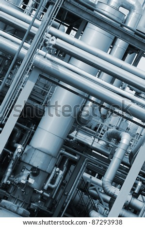 pipelines, constructions inside large oil and gas refinery, blue toning concept