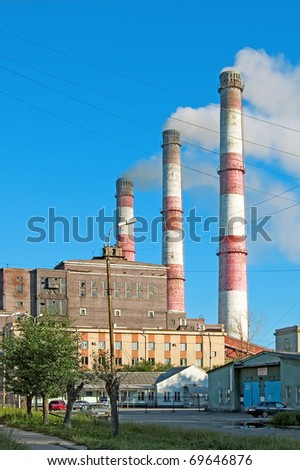 Pipes and building hydropower plants on the background of blue sky in the town of Serov #69646876