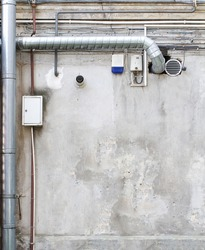 Pipes and wires on the wall.