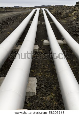 Pipes carrying geothermal energy across a lava field in Iceland