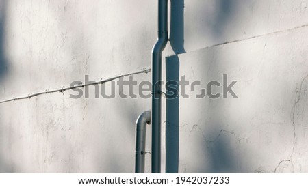 Pipes in a shadow white wall stock photo