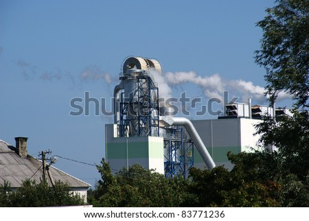 Pipes of a factory on a background of the blue sky