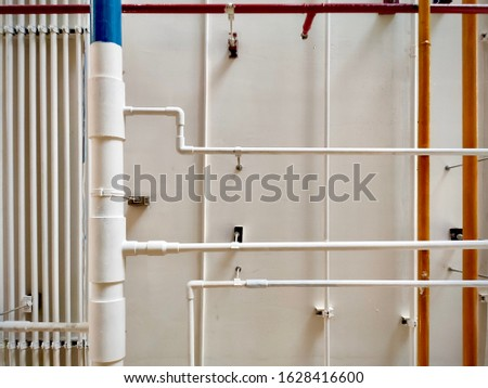 Pipes of the gas boiler building, pipe for water piping system, became rusty on the wall and the ground. Damaged Pipes of the gas boiler building, pipe for water piping system.