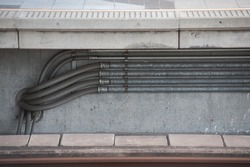 pipes on cement wall / abstract grungy background
